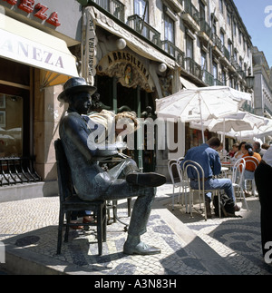 WOMAN LOOKING AT BRONZE STATUE OF POET  FERNANDO PESSOA  IN FRONT OF  BRASILEIRA  CAFE LISBON PORTUGAL - Stock Photo