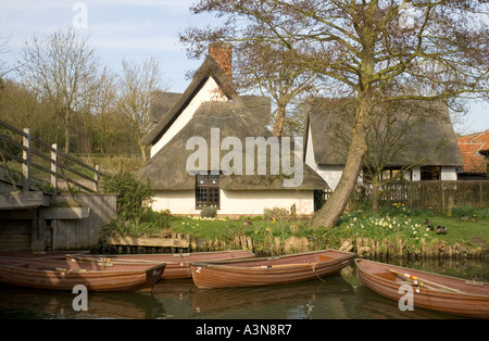 Thatched Cottage and Boats for Hire on River Stour at Flatford Suffolk - Stock Photo