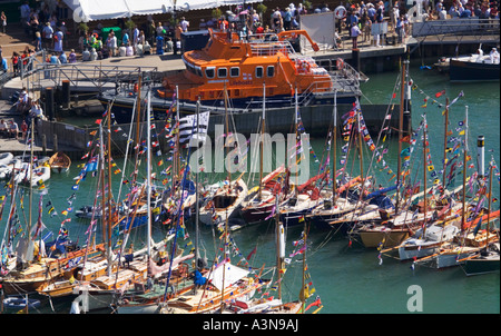 Aerial view Old Gaffers Festival. RNLI lifeboat moored at Yarmouth harbour. Isle of Wight. UK.