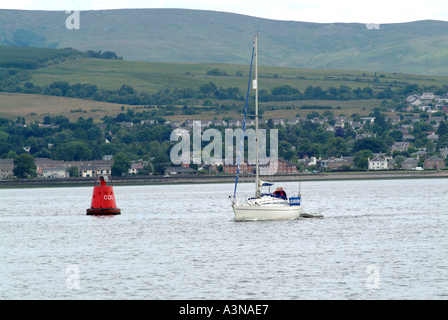 Yacht on River Clyde Passing Red Buoy in the Firth of Clyde Helensburgh Dumbartonshire Scotland United Kingdom UK - Stock Photo