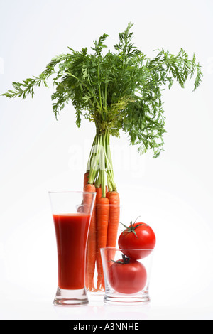 Vegetable Juice and Fresh Vegetables in Glasses - Stock Photo
