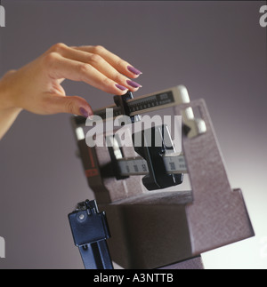 Womans Hand On Doctors Weight Scale Weighing Health Weigh - Stock Photo