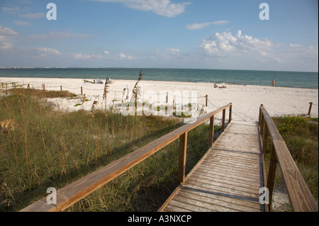 Wooden walkway to Lighthouse Beach on Sanibel Island on the Gulf of Mexico Coast of Florida - Stock Photo