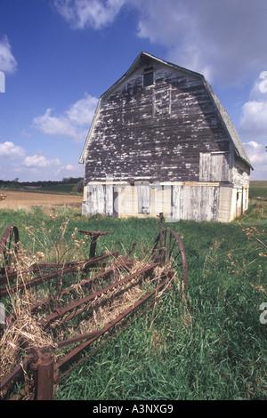 Old Barn And Rusting Farm Machinery, Brown Michigan, USA - Stock Photo