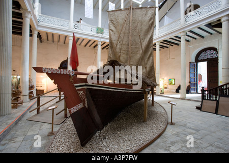 Zanzibar Tanzania A Traditional Dhow boat on dislay inside The House of Wonders National Museum in Stone Town - Stock Photo