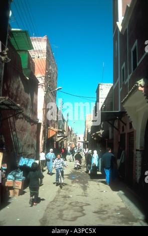 Typical back street scene near the Place Djemaa el Fna Marrakesh Morocco - Stock Photo