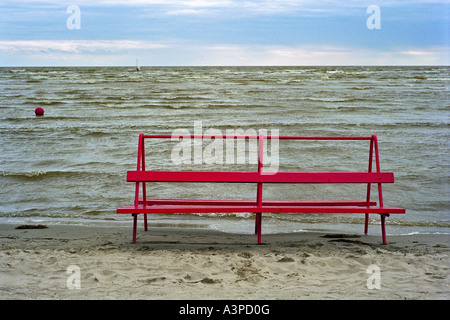 An empty beach bench at the Parnu Bay, Estonia - Stock Photo