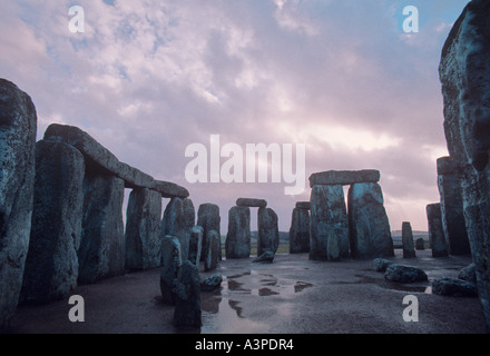 The massive Sarsen stones of Stonehenge circle against breaking storm clouds Wiltshire England - Stock Photo