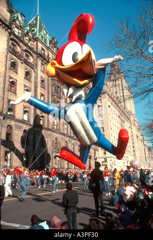 'Thanksgiving Day Parade' 'New York' 'Helium Balloon' Cartoon Figure 'Woody Woodpecker' Floating Above 'Fifth Avenue' - Stock Photo