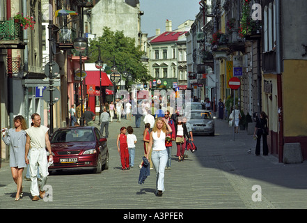 People walking in the old town of Przemysl, Poland - Stock Photo