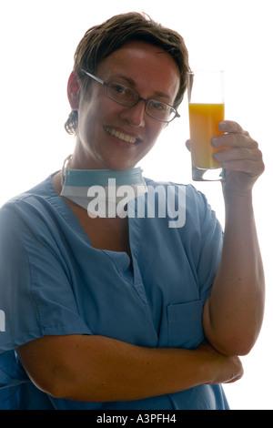 Female Dietitians, Nutritionists, doctor drinking orange juice - Stock Photo