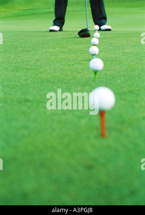 Golfer on driving range, low section - Stock Photo