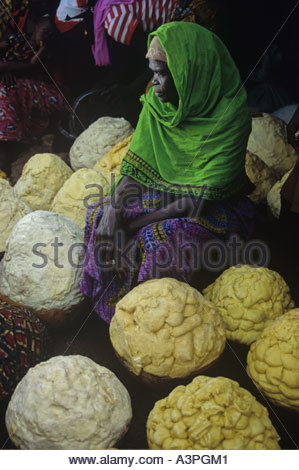 Dagomba woman at Tamale market Butter made from shea nuts in Northern Ghana Used for cosmetics and cooking - Stock Photo
