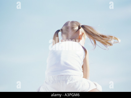Little girl with pigtails, rear view - Stock Photo