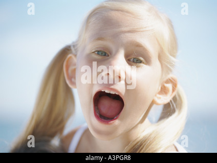 Girl with mouth wide open - Stock Photo