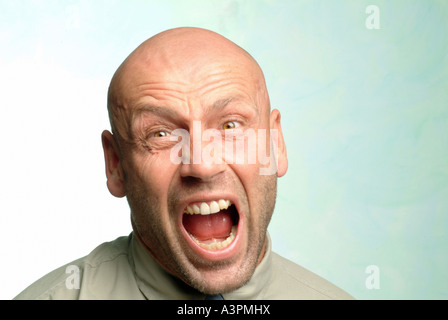 Man with a crazy look on his face - Stock Photo
