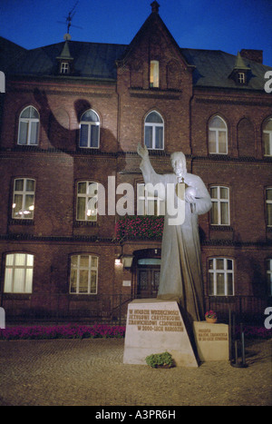 Statue of Jesus at night in Poznan, Poland - Stock Photo