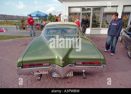 A Buick Riviera at a motorway restaurant, Poland - Stock Photo