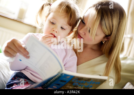 Mother reading with daughter - Stock Photo