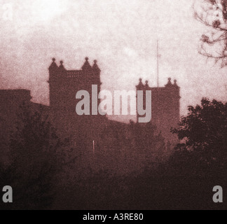 Evocative urban and industrial night scene showing the silhouette of Mutual Mills in Heywood Lancashire UK - Stock Photo