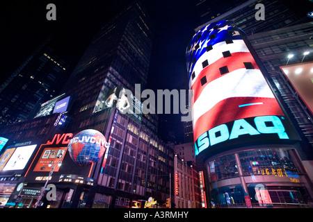 The American flag displayed on Nasdaq ad screen Times Square NYC USA - Stock Photo
