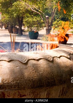 Stock photograph of incense burning in a big pot at Po Lin Monastery on Lantau Island in Hong Kong 2006 - Stock Photo