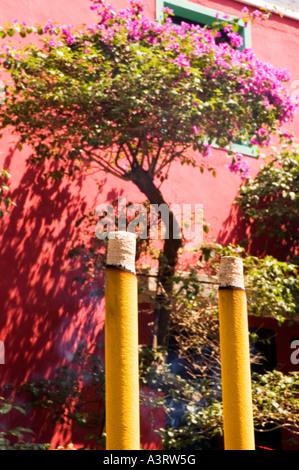 Stock photograph of incense sticks burning against a pink wall at Po Lin Monastery on Lantau Island in Hong Kong - Stock Photo