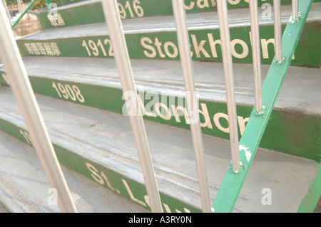 Beijing Olympics of 2008 is celebrated with this painting on these steps over a main road in Hong Kong. - Stock Photo