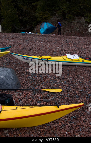 A group of sea kayakers load their boats in Lake Superior Provincial Park near Wawa Ontario Canada - Stock Photo