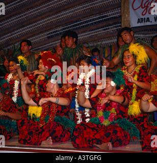 Group of local Samoan dancers in colourful dress wearing leis at Aggie Grey's Hotel in Apia town on Upolu Island - Stock Photo