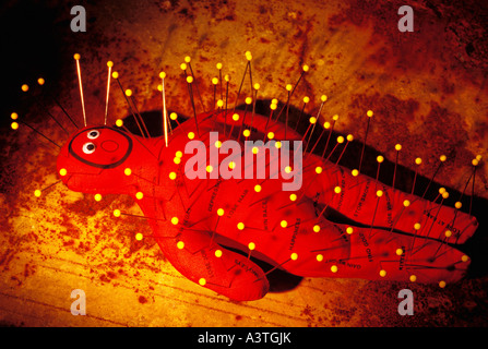 Voodoo doll with pins - Stock Photo