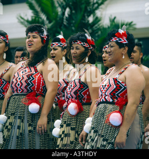 Group of female Maori singers and dancers from New Zealand in traditional dress poi balls tied to their waists - Stock Photo