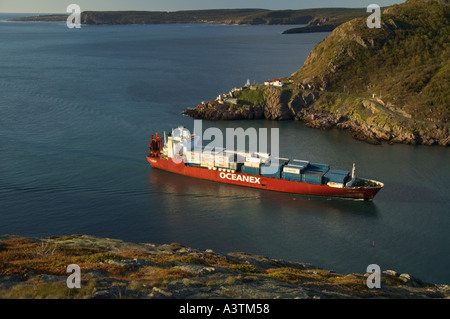 Canada Newfoundland St John s container ship entering harbour narrows Fort Amherst - Stock Photo