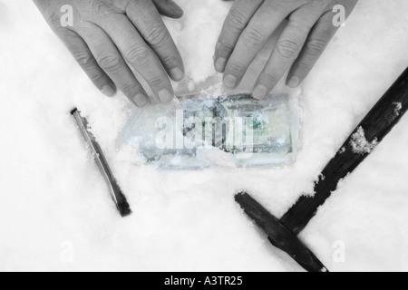 Twenty Dollar Bill US Dollars in Ice Frozen Assets money concept - Stock Photo