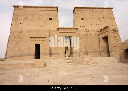 First pylon of Isis Temple, UNESCO World Heritage Site, Philae Island, Aswan, Egypt - Stock Photo