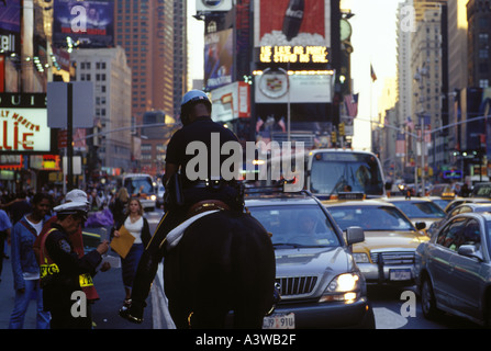 A mounted police officer in Times Square in the center of New York City - Stock Photo