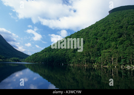 PROFILE LAKE BELOW THE OLD MAN OF THE MOUNTAIN, FRANCONIA NOTCH STATE PARK, NEW HAMPSHIRE. SUMMER. JULY. - Stock Photo