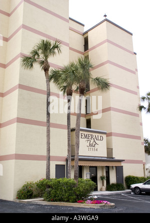 Condominiums and palm trees lining Gulf Boulevard. North Redington Beach Florida USA - Stock Photo