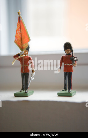 toy soldiers on windowsill - Stock Photo