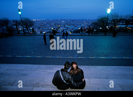 Paris couple in love cuddling on Sacre Coeur hill - Stock Photo
