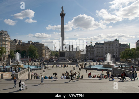 Trafalgar Square two full height fountains Nelsons Column and iconic London view looking towards Big Ben down Whitehall - Stock Photo