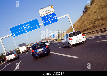 Cars driving through A5 highway in Portugal. - Stock Photo