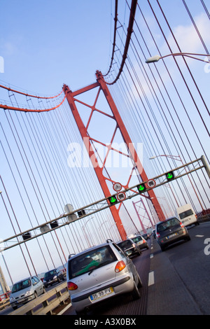 25 de Abril bridge in Lisbon, Portugal. A suspension bridge twin of the Golden Gate bridge and built by the same - Stock Photo