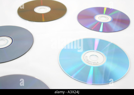 several cd s isolated over white with light reflections - Stock Photo