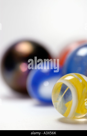 Closeup of marbles on a white surface - Stock Photo