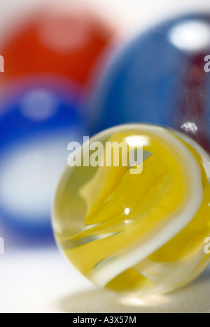 Marbles on a white surface - Stock Photo