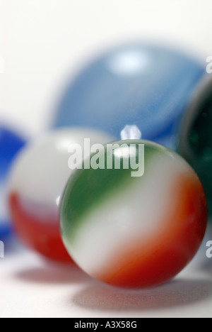 Green White and Red marble with others in background - Stock Photo