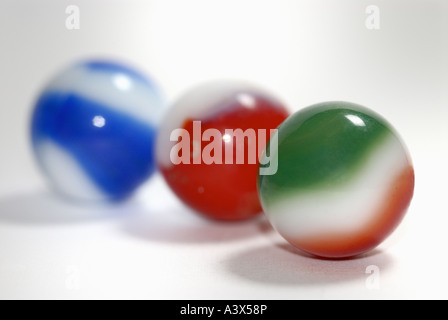 three marbles on a white surface - Stock Photo