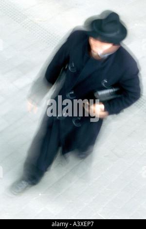 man walking moving fuzziness - Stock Photo