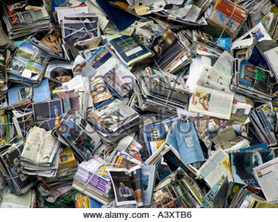 piles of magazines and newspapers for recycling - Stock Photo